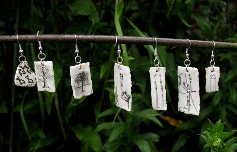 Earrings 150 SEK/pc. Available in several variations. Silver-plated. Stoneware.